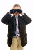 Young boy with binoculars Stock Images