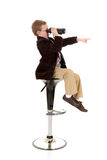 Young boy with binoculars Stock Photo