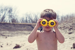 Young boy with binoculars Royalty Free Stock Images