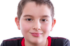 Young Boy in Black and Red Shirt Smiling at Camera Royalty Free Stock Photography