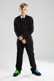 Young boy in black suit and colorful shoes Stock Photo