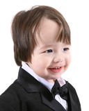 Young boy in black tuxedo Royalty Free Stock Photos