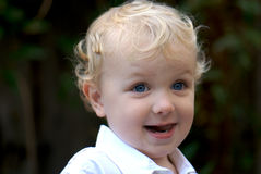 Young boy with blonde hair. Two year old boy with big blue eyes Stock Photos