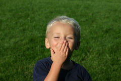 Young Boy Blowing Kiss. Young boy outdoors blowing a kiss goodbye Royalty Free Stock Photo