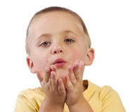 Young boy blowing kisses Royalty Free Stock Photo