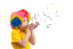 Young boy blows out confetti Stock Image