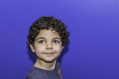 Young Boy with Blue Background Stock Image