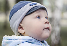 Young boy with blue eyes  looking up. Closeup portrait of a young boy with blue eyes  looking up Stock Photography