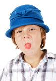 Young boy in blue hat is making faces Stock Image