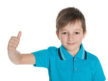 Young boy in the blue shirt holds his thumb up Royalty Free Stock Photos