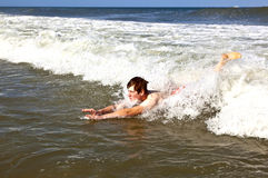 Young boy is body surfing in the waves Stock Image