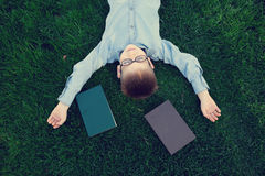 Young boy with a book slipping Stock Image