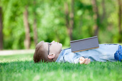 Young boy with a book slipping Royalty Free Stock Image