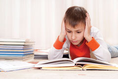 Young boy with books Royalty Free Stock Images