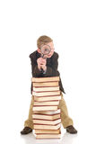 Young boy on books Royalty Free Stock Images