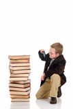 Young boy on books Royalty Free Stock Photography