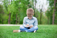 Young boy with a books Royalty Free Stock Photo
