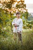 Young boy with a bow Royalty Free Stock Photos