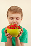 Young boy with bowl of sweet strawberries. Young boy with a bowl of sweet strawberries Stock Photography