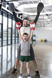 Young boy boxer with his coach at training Royalty Free Stock Image