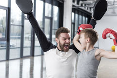 Young boy boxer with his coach at training Royalty Free Stock Photography