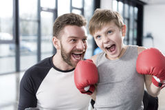 Young boy boxer with his coach at training Royalty Free Stock Images