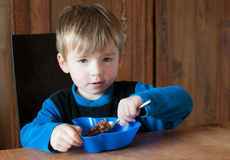 Young boy at breakfast Stock Photo
