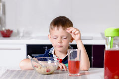 Young Boy at Breakfast Table with Eyes Closed Royalty Free Stock Photo