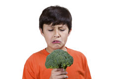 Young boy with broccoli Royalty Free Stock Images