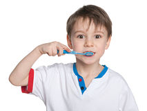 Young boy brushing her teeth Royalty Free Stock Images