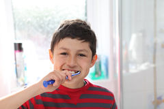 Young boy brushing his teeth Royalty Free Stock Photo