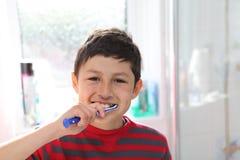 Young boy brushing his teeth Royalty Free Stock Photo