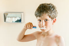 Young boy brushing teeth Royalty Free Stock Photos