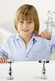 Young Boy Brushing Teeth at Sink Stock Photos