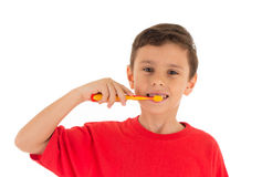 Young Boy brushing teeth Stock Photos
