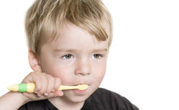 Young boy brushing teeths Stock Photography
