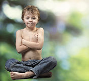 Young boy Buddha on green forest Stock Photos