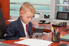 Young Boy in Business Office Royalty Free Stock Photo