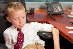 Young Boy in Business Office Stock Images