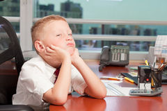 Young Boy in Business Office Stock Photography