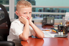 Young Boy in Business Office Royalty Free Stock Photography