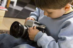 Young boy with camera Stock Photography