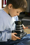 Young boy with camera Royalty Free Stock Photo