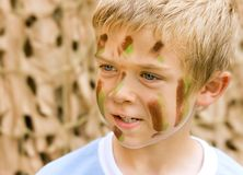 A young boy with camouflage paint Royalty Free Stock Images