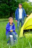 Young boy camping Stock Images