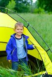 Young boy camping with tent Royalty Free Stock Photography