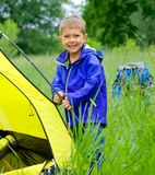 Young boy camping with tent Royalty Free Stock Image