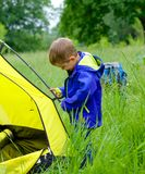 Young boy camping with tent Stock Images