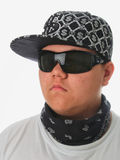 Young boy with cap. And bandanna. Close up on white background Stock Images