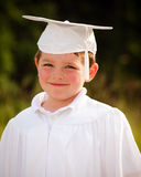 Young boy with cap and gown Royalty Free Stock Images